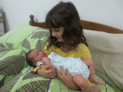 Svara loves to hold her new sister!  Unfortunately Talisa doesn't enjoy it as much and it never lasts long.