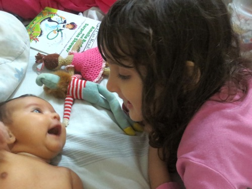 Talisa gave her first smiles to Svara.  It's obvious that she adores her big sister as much as her big sister adores her!