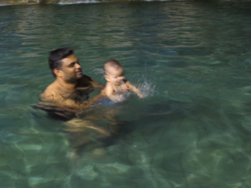first swim - she's in love with splashing, a water baby just like her big sister!