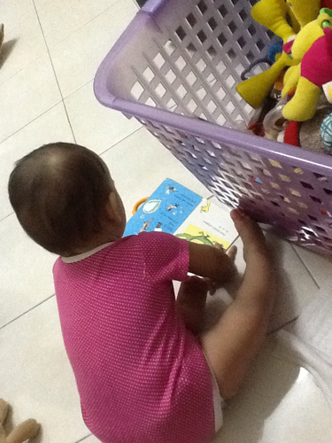 Reading a book to herself