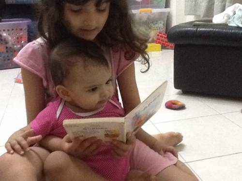 Svara reading a book to Talisa.  I love these moments!