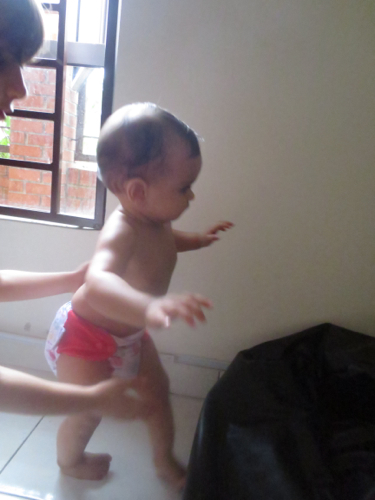 Some of Talisa's first steps, with big sister nearby in case she falls!