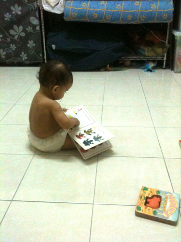 """She looks so cute sitting by herself and """"reading"""" books"""