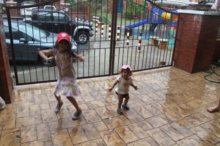 "Dancing in the rain!  She now says ""NAIN!"" every time she sees it rain."