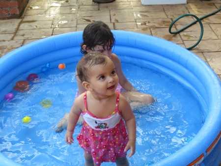 Swimming, a favorite pasttime.  This girl loves water, just like her big sister.
